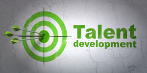 Education concept: target and Talent Development on wall